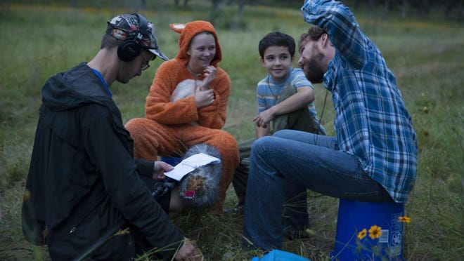 Director Micah Barber demonstrates an action to Thomas (played by Bryce Gheisar) and Felix theby Delaney Wingrove) before a take.
