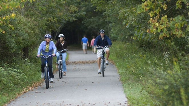 Bicyclists ride on the limestone surface along the North Central State Trail that runs from Gaylord to Mackinaw City.