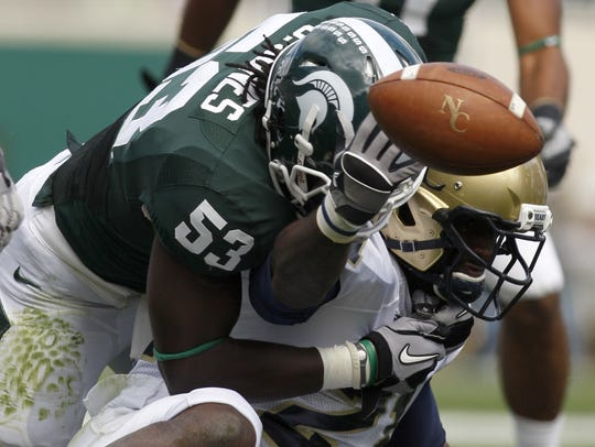 The ball pops loose as Michigan State linebacker Greg