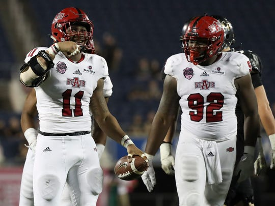 Arkansas State Red Wolves defensive end Ja'Von Rolland-Jones, left, ranks second in the country with 14.0 sacks.