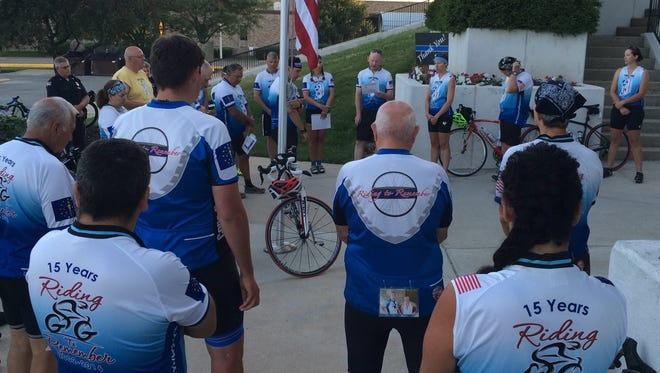 Participants in the Cops Cycling for Survivors tour of Indiana conduct a service honoring Wayne County law enforcement officers killed in the line of duty.