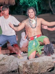 The Mana Hune dance group performs with patrons at