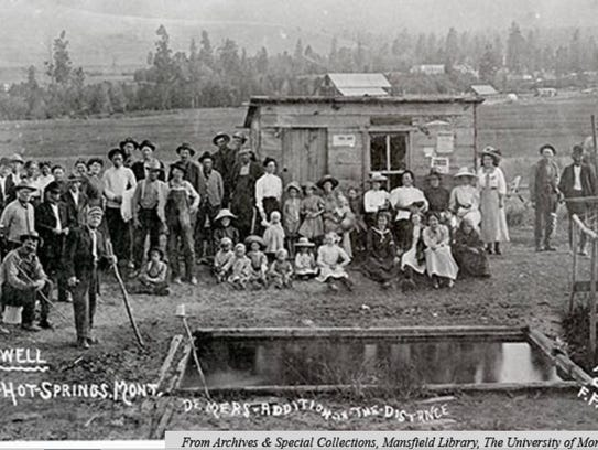A large group of people pose for a photograph at Camas