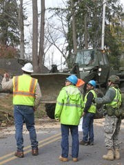 Members of the Army National Guard work with Con Edison to clear large trees from Croton Lake Road in Bedford Hills in the wake of Superstorm Sandy Nov. 1, 2012. ( Frank Becerra Jr / The Journal News )