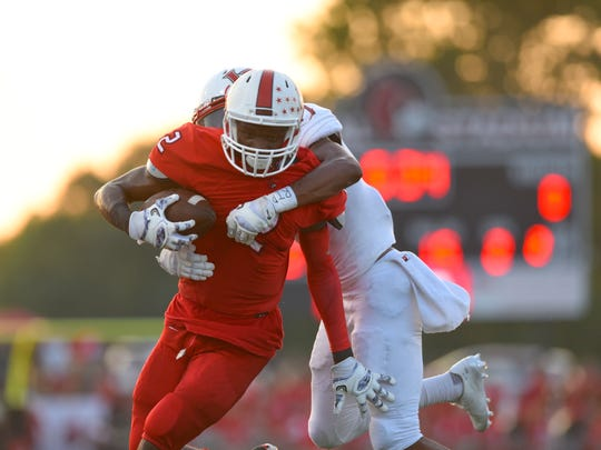 Javon Hicks rushes for a big gain against LaSalle.