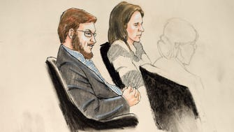 A courtroom sketch from Jan. 20, 2015, shows accused murderer James Holmes, left, sitting with Tamara Brady, Arapahoe County public defender, at the Arapahoe District Courthouse in Centennial, Colo.