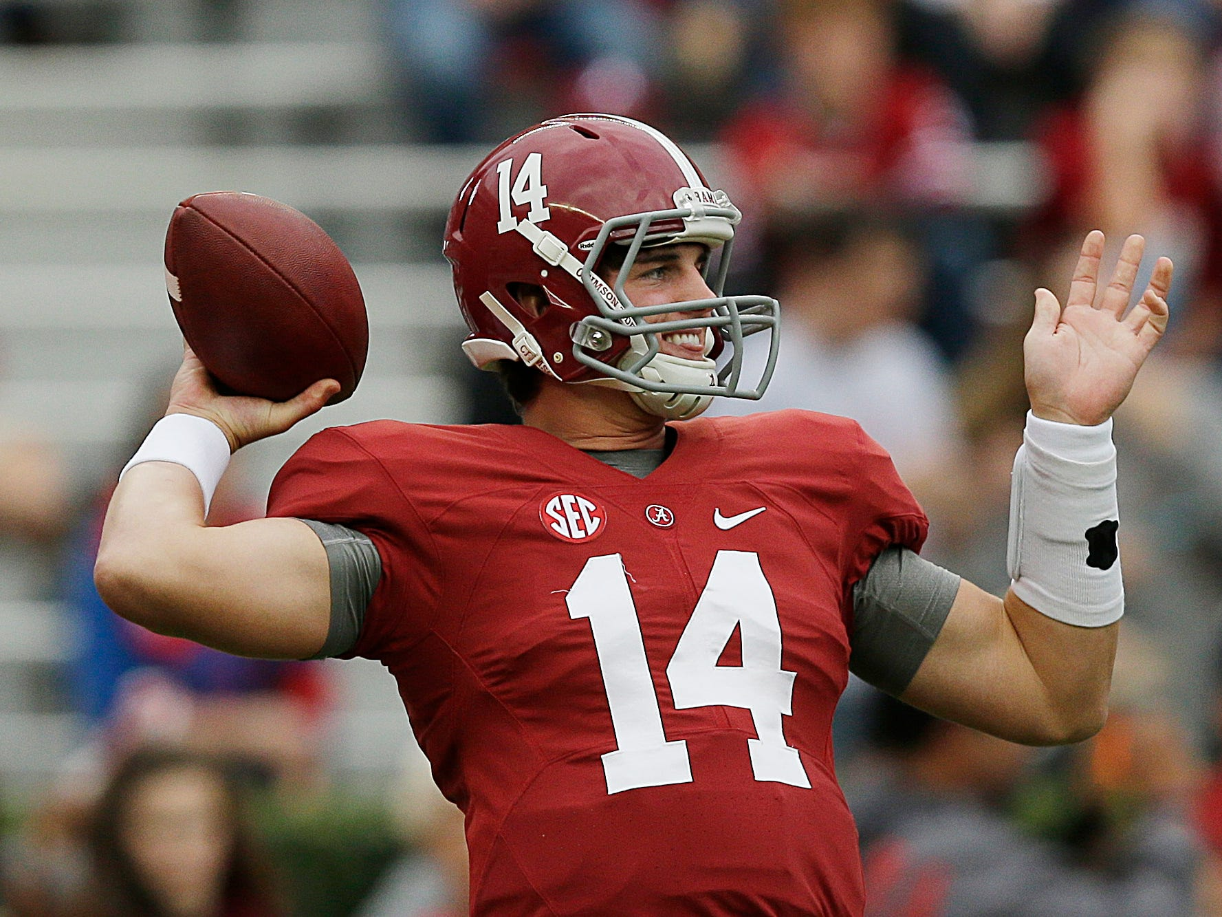 Alabama quarterback Jake Coker (14) sets back to pass before the first half of an NCAA college football game, Saturday, Oct. 10, 2015, in Tuscaloosa, Ala. (AP Photo/Brynn Anderson)