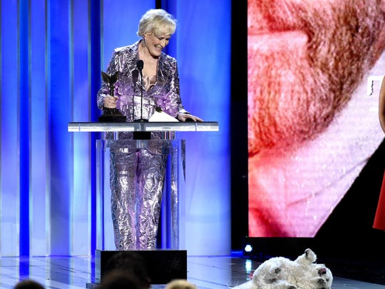 "Glenn Close, winner of the award for best female lead for ""The Wife,"" reacts as her dog, Sir Pippin of Beanfield, rolls onstage at the 34th Film Independent Spirit Awards on Saturday, Feb. 23, 2019."