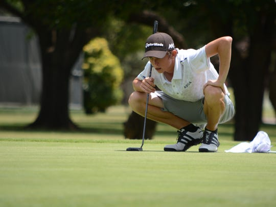 Merkel's Colton Hilburn lines up his putt on No. 17 during the second round of the American Junior Golf Association's Folds of Honor Junior Championship at Abilene Country Club's Club Course.