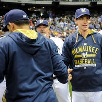 Milwaukee Brewers manager Craig Counsell celebrates with players after beating the Los Angeles Dodgers 4-3 in his managerial debut.