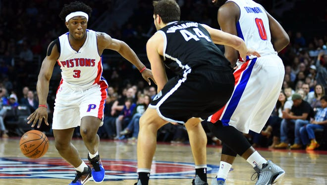 Pistons forward Stanley Johnson (3) goes to the basket against  Nets guard Bojan Bogdanovic (44) during the first quarter of the Pistons' 115-103 win Saturday at the Palace.