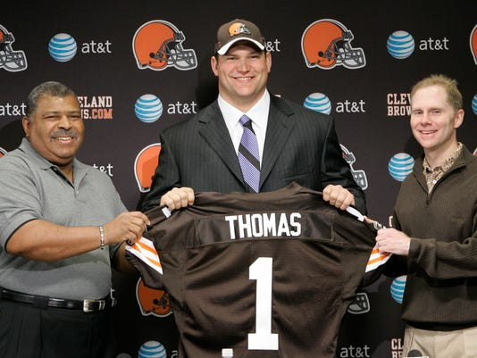FILE - In this April 29, 2007, file photo, Cleveland Browns 2007 NFL draft first round pick Joe Thomas is flanked by head coach Romeo Crennel, left, and general Manager Phil Savage nduring a press conference in Berea, Ohio.  Browns star left tackle Joe Thomas has retired after 11 seasons in the NFL, ending a career in which he exemplified durability, dependability and dominance. A 10-time Pro Bowler, Thomas announced his decision Wednesday, March 14, 2018,  after spending several months contemplating whether to come back following a season-ending injury.(AP Photo/Tony Dejak, File)