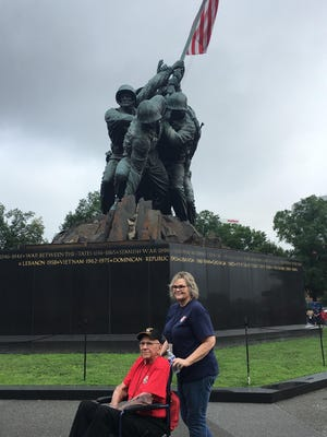 Bruce Knoch, 90, of Visalia, visits the Marine Corps War Memorial in Washington, D.C. with his daughter Patty. Knoch, who witnessed the flag being raised at Iwo Jima from a minesweeper in 1945, was one of 65 local veterans who participated in the Central Valley Honor Flight.