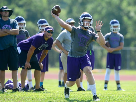 Mitchell quarterback Ben Young throws a pass during the FCA annual 7-on-7 tournament at Erwin High School on Thursday, July 13, 2017.