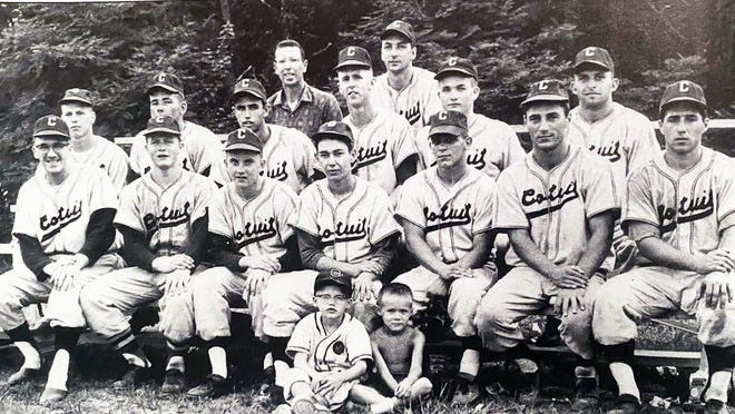In 1962, the Cotuit Kettleers won their second straight title. In the back row are team general manager Arnold Mycock and team manager Jim Hubbard.