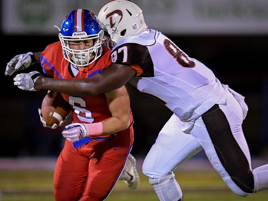 DeSales High School Demetri Scott tackles  Christian Academy of Louisville's Luke Purvis during the game in Louisville, Friday, Oct. 6, 2017.