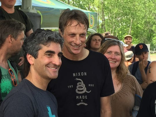 Grand skatepark opening on the waterfront: Burlington Mayor Miro Weinberger, at left, poses with professional skateboarder Tony Hawk on June 4, 2016. Right of Hawk stands Kirsten Merriman Shapiro, who managed much of the decade-long project through the city's Community and Economic Development Office.