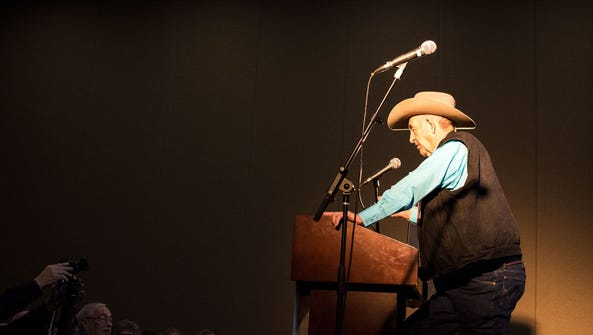 A cowboy poet recites his work at the National Cowboy