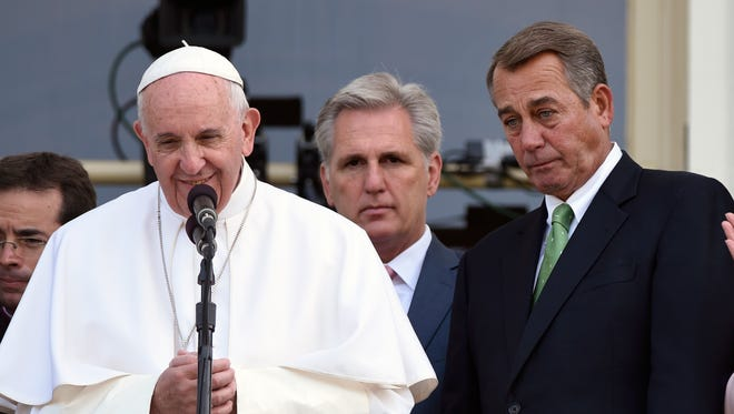 House Speaker John Boehner of Ohio becomes emotional as Pope Francis appears on the Speaker's Balcony on Capitol Hill, Thursday,  and addresses the waiting crowd below on the Capitol grounds. The pope addressed a joint meeting of Congress before stepping out on the balcony. Between the pope and Boehner is Majority Leader Kevin McCarthy of California.