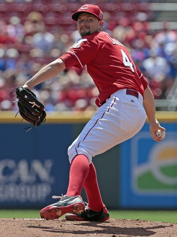 Reds starting pitcher Mike Leake delivers a pitch in