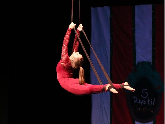 Hannah Peters performs on the aerial straps.