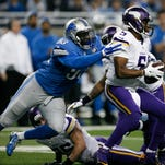 Dec 14, 2014; Detroit, MI, USA; Detroit Lions defensive end George Johnson (93) sacks Minnesota Vikings quarterback Teddy Bridgewater (5) during the first quarter at Ford Field. Mandatory Credit: Raj Mehta-USA TODAY Sports