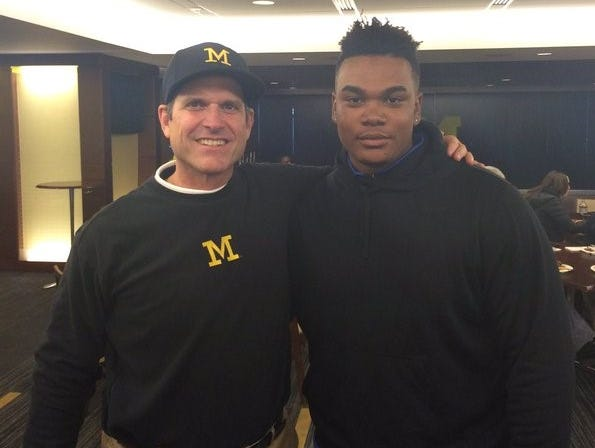 Michigan coach Jim Harbaugh and newly committed defensive tackle Jordan Elliott.