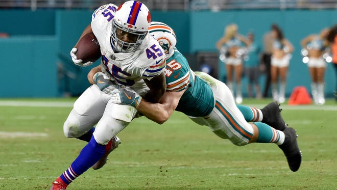 Buffalo Bills running back Marcus Murphy (45) is tackled by Miami Dolphins outside linebacker Mike Hull (45) during the second half at Hard Rock Stadium. Mandatory Credit: Steve Mitchell-USA TODAY Sports