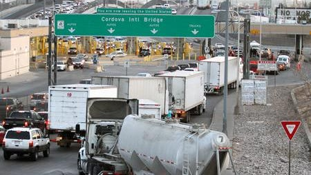Trucks line up in El Paso to enter the free Bridge of the Americas. Increased trade spurred on by the North American Free Trade Agreement has helped the economies in El Paso and other border cities, a Federal Reserve Bank of Dallas report concludes.