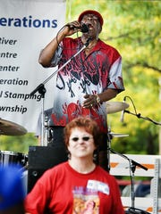 Freddie Cunnigham, lead singer of Root Doctor, performs during the Old Town Blues Festival,  Sept. 17, 2005 in Old Town Lansing.