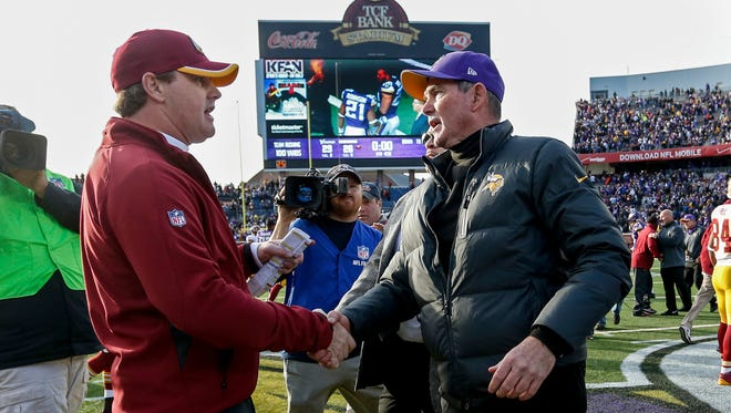 Former Cincinnati Bengals assistants Jay Gruden, left, and Mike Zimmer are now division-winning head coaches in Washington and Minnesota, respectively.