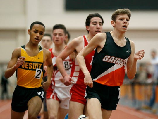 McQuaid's Abel Hagos finished second and Churchville-Chili's Payton Gleason first in the 1600 Meter Run Class A during the Section V Class A and D Indoor Track Championships at the Gordon Field House of the Rochester Institute of Technology.