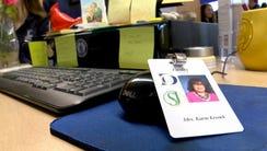 Donovan Catholic drama director Karin Krenek's ID badge