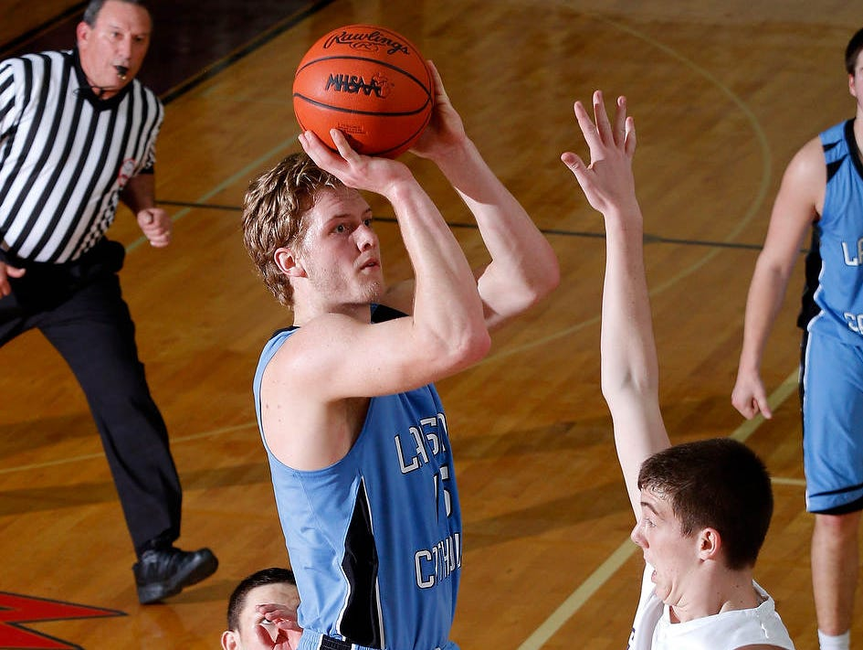 Tony Poljan became Lansing Catholic's career basketball scoring leader in March.