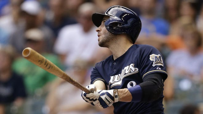 Milwaukee Brewer Ryan Braun hits a home run against the Miami Marlins during the sixth inning on Wednesday in Milwaukee. Braun became the franchise's all-time home-run leader.