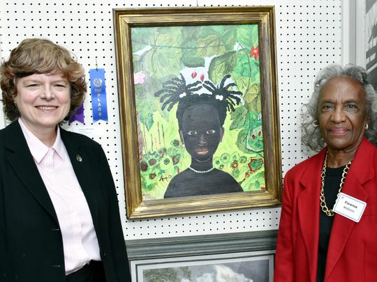 Union County Freeholder Vice Chairman Bette Jane Kowalski congratulateFlorence McGlohn of Roselle on winning first place in the non-professional acrylic category and Best in Show during the opening reception of the 2018 Union County Senior Citizens Art Exhibit in Union.