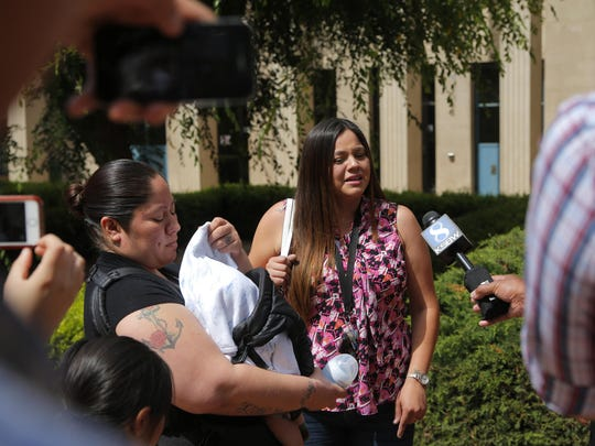 The sisters of Jose Velasco, who appeared in crutches Wednesday at the Monterey County Superior Court in Salinas, speak to the media after the court hearing.
