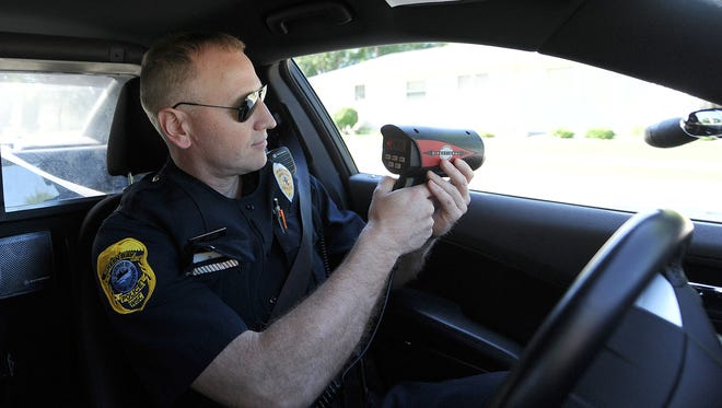 Green Bay police officer Tom Herber looks for speeders. Green Bay police have stepped up speed enforcement this year in response to community complaints.