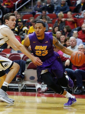 Northern Iowa guard Jordan Ashton (23) drives the ball past Iowa Saturday, Dec. 17, 2016, during their game in the Hyvee Classic at Wells Fargo Arena in Des Moines.