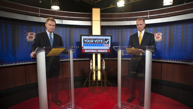 The two candidates for mayor of Indianapolis, Democrat Joe Hogsett, left, and Republican Chuck Brewer, prepared to participate in a debate Friday, Oct. 16, 2015, at the WISH-8 studios in Indianapolis.