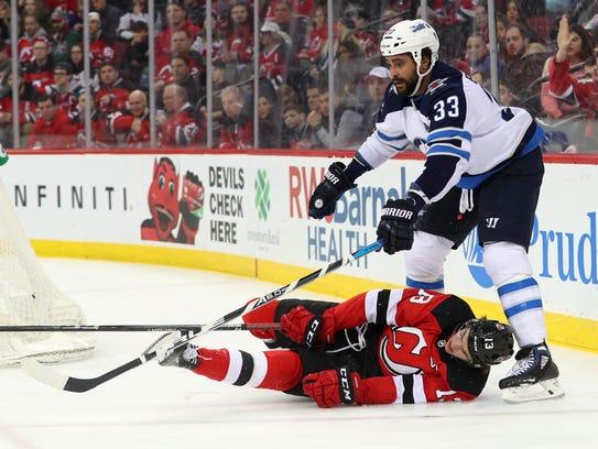Winnipeg Jets defenseman Dustin Byfuglien (33) knocks