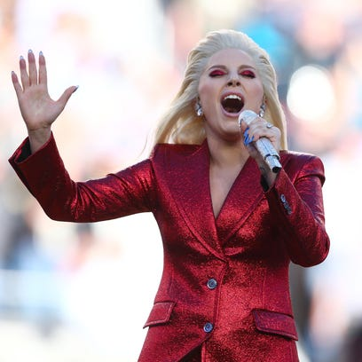 Recording artist Lady Gaga performs the national anthem
