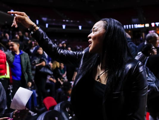 South Carolina's head coach Dawn Staley waves to the fans as he heads off the court following the second half of an NCAA college basketball game against Temple, Thursday, Dec. 21, 2017, in Philadelphia. South Carolina won 87-60. (AP Photo/Chris Szagola)