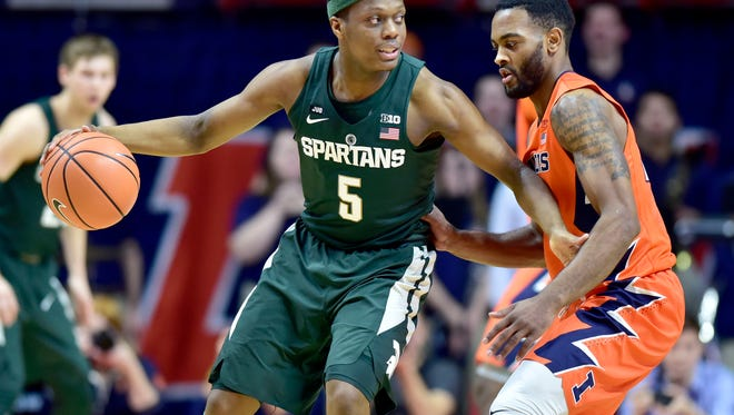 Michigan State guard Cassius Winston (5) looks for room to pass against the defense of Illinois guard Mark Alstork (24) during the first half on Monday, Jan. 22, 2018, in Champaign, Ill.