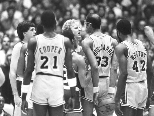 FILE - In this June 6, 1984, file photo, Los Angeles Lakers' Kareem Abdul-Jabbar and Boston Celtics Larry Bird face off during an NBA playoff game in Los Angeles. By the time the Los Angeles Lakers met the Boston Celtics for the third time in the NBA Finals in the 1980s, defensive stopper Michael Cooper had enough with Larry Bird, Kevin McHale and the rest of the Celtics. It's the rivalry against which all others are measured, the one essentially responsible for the modern NBA evolving from a fringe sport that put its championship series on tape delay to a global sensation built around the most recognizable athletes in American sports. (AP Photo/Lennox McLendon, File)
