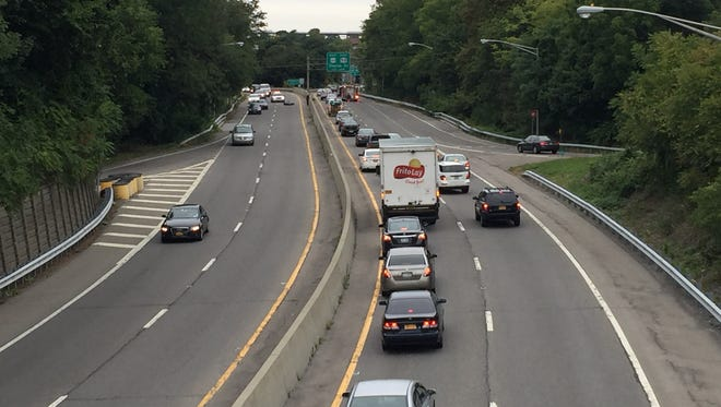 Traffic is seen backed up in the northbound lanes of Route 9 near an accident. In the southbound lane, a motorcycle can be seen.
