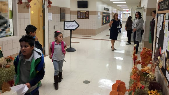 Students and administrators stand in the Montana Vista Elementary School hallway.