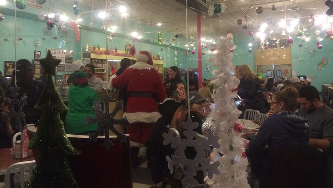 Santa pays a visit to the Pop Shop in Collingswood.