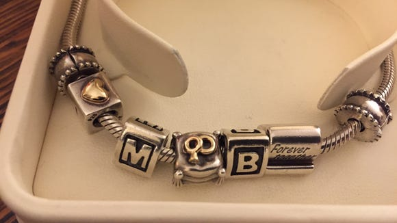 Mama's Pandora bracelet with the charms Pops decided to keep. The heart, the M for Michael, the interlocked rings, the B for Brenda and the forever charm.