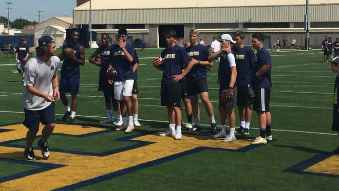 San Diego Chargers quarterback Zach Mettenberger, left, leads drills at the A4 Ann Arbor Aerial Assault camp on the campus of Michigan on Saturday, June 18, 2016.